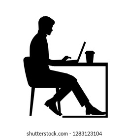 black silhouette of a man sitting behind a computer icon vector, working man with coffee, workplace concept, student working at laptop