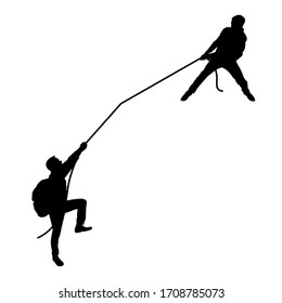 Black silhouette of men. The man pulls another rope. Teamwork. Tourists, travelers, climbers, adventurers, hiking. Mountain trip.