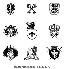Black silhouette mixed heraldry set.A collection of nine different black coat of arms.Seahorses with a crown and anchor, two key three lion in a shield, two sea monsters with a crown and anchor...