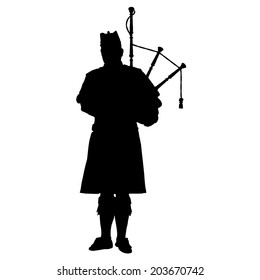A black silhouette of a Scottish piper playing the bagpipes