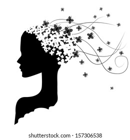 a black silhouette of a woman with a butterfly brain