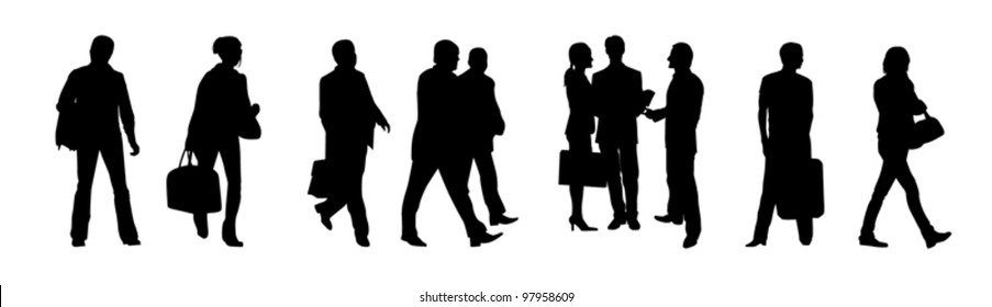 Black silhouettes of business people on the white background