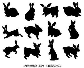 Black silhouettes of Easter bunnies. Seamless background pattern. Set. Cartoon vector element.