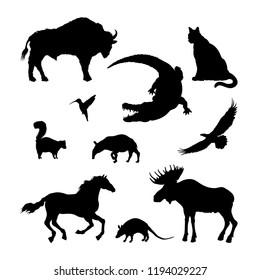 Black silhouettes of North American animal. Isolated image of elk, bison, crocodile on white background. Wildlife graphic. Vector illustration