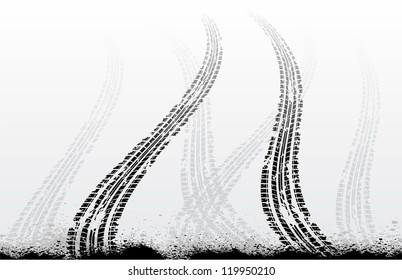 Black tire tracks with ink blots