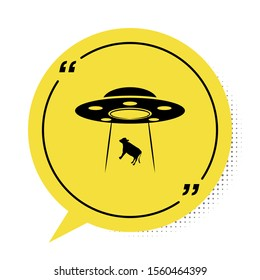 Black UFO abducts cow icon isolated on white background. Flying saucer. Alien space ship. Futuristic unknown flying object. Yellow speech bubble symbol. Vector Illustration