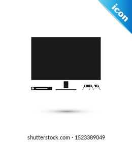 Black Video game console icon isolated on white background. Game console with joystick and lcd television.  Vector Illustration