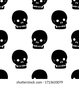 Black and white Cartoon skull is in Seamless pattern
