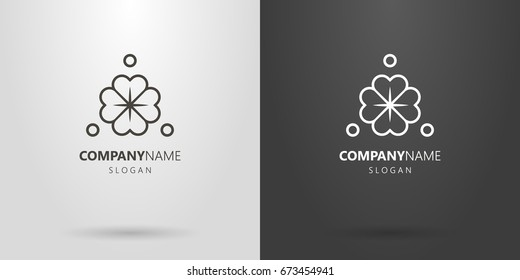 Black and white four-leafed clover logo