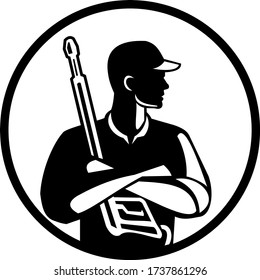 Black and White Illustration of power washer worker with arms crossed holding pressure washing gun looking to the side viewed from front set inside circle on isolated background done in retro style.