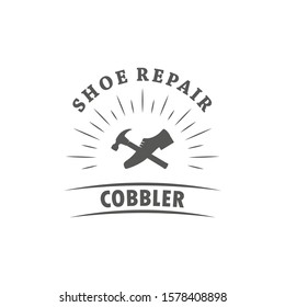 Black and white illustration of a shoemaker logo. Vector illustration of shoes, hammer and text with rays on a white background. Professional shoemaker services.