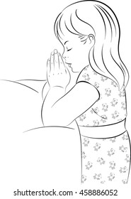 Black and white line drawing of a young girl wearing pajamas, kneeling beside her bed with her hands together saying her bedtime prayers.