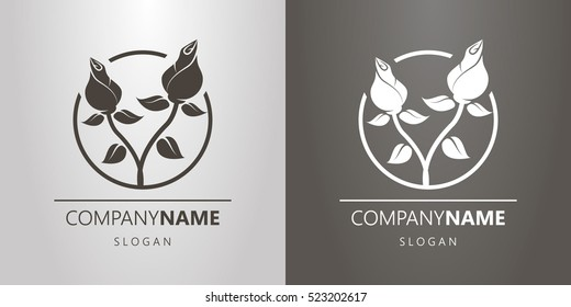 black and white logo with two entwined roses in a circle