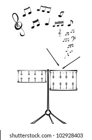 Black and white picture of two drums with notes.