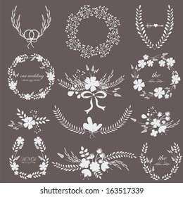 Black and white romantic wedding set with laurels, flowers and bouquets isolated on black background.