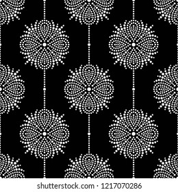 Black and white seamless garlands pattern of mosaic dotted flowers, snowflakes, stars. Floral lattice print of beads. Vector Illustration.
