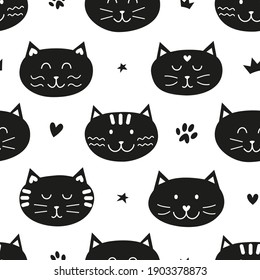 Black and white seamless pattern with cat faces and stars, hearts, paws for kid clothing, baby shower, wrapping paper.