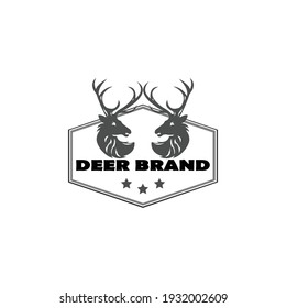 black and white simple vector symbol of the deer head in the laurel wreath