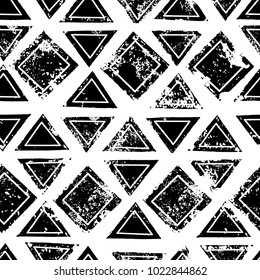 Black and white triangles and squares aged geometric ethnic grunge seamless pattern, vector