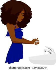 A black woman in a blue blouse washes her hands with soap at a sink.