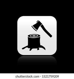 Black Wooden axe in stump icon isolated on black background. Lumberjack axe. Axe stuck in wood. Silver square button. Vector Illustration