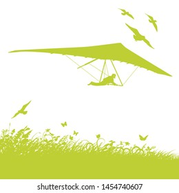 Blades of grass, birds and a hang glider
