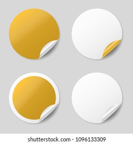 Blank gold round stickers with curled corners, realistic mockup
