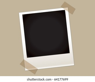 Blank instant photo with two taped corners