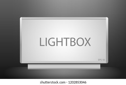 Blank lightbox in the dark. Illuminated lightbox screen with empty space for design.