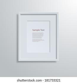 Blank modern A4 frame on a white wall.