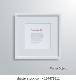 Blank modern square frame on a white wall.