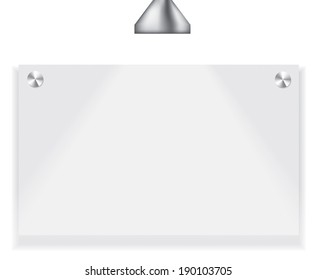 Blank paper on white wall. The lamp is shinig on it