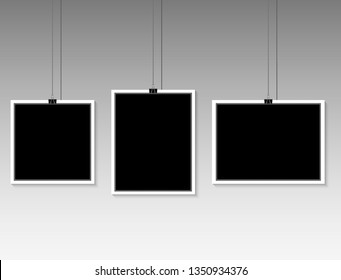 blank photo frame hanging on a line