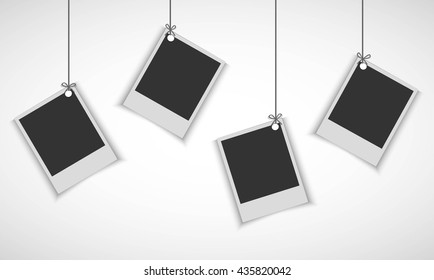 Blank photo frame hanging on line