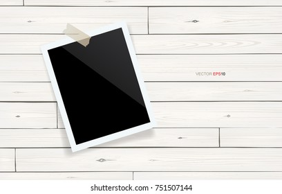 Blank photo frame or picture frame stick on white wooden wall. Vector vintage background.