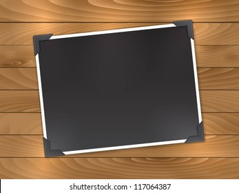 Blank photo on a wooden background