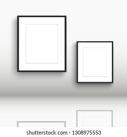 Blank picture frames on a wall with reflections in the floor