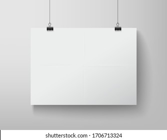 blank white banner hanging on the clamps on white background