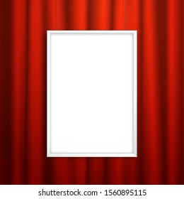 Blank white frame for an image or poster hanging near the red curtain. Mockup for design