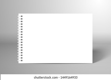 Blank white spiral notebook or album. Mockup for design with shadow