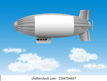 Blimp in flight over white clouds against blue sky
