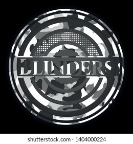 Blinders written on a grey camouflage texture