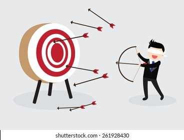 Blindfold businessman try to hit a target