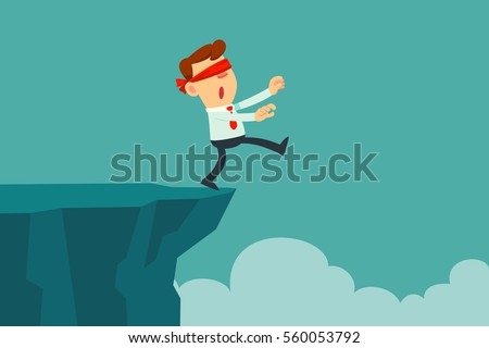 blindfolded businessman walk to the cliff. Business concept
