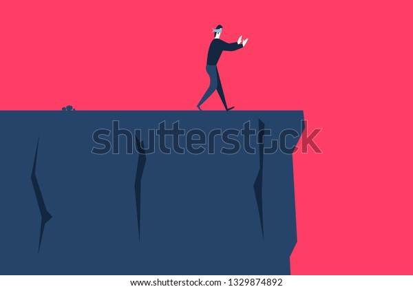 A blindfolded man goes to the cliff