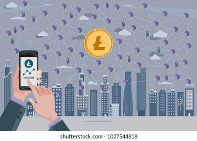Blockchain network concept with Litecoin cryptocurrency. In the foreground hands with a mobile phone with the Litecoin icon.