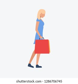 Blondie girl with shopping bags. Figure, woman, bag. Can be used for topics like  businessman, shopping, supermarket, lifestyle