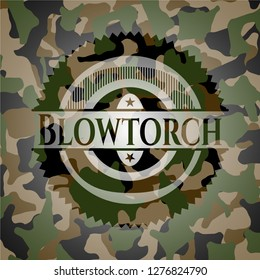 Blowtorch on camouflage texture