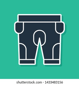 Blue American football shorts icon isolated on green background. Football uniform sign.  Vector Illustration