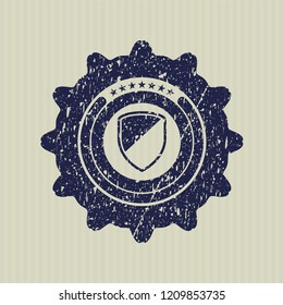 Blue armor icon inside distress rubber grunge stamp
